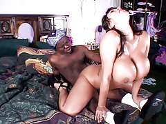 Sexy big tit asian prostitute sucks and drills on a midgets cock.