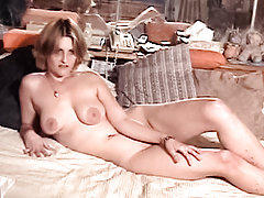 Slutty blonde with big natural tits poses fingers herself