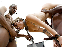 Tag-team by 2 big black cocks in a scene from Ebony Meat 3