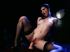 Ink queen Joanna Angel fucks she is with a sextoy on a desk!
