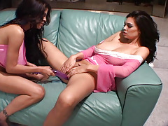 Tera Patrick playing with her girlfriend and a purple dildo!
