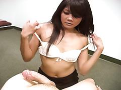 Cute Asian slut hits one guy's balls while giving a handjob