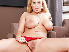 Sexy Angel Wicky in red underwear fingers her wet pussy.