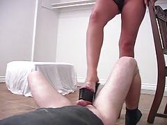 Super sexy blonde kicking geek guy's eggs in fem-dom video