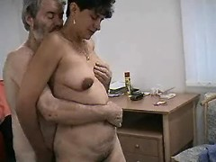 Aged woman in threesome