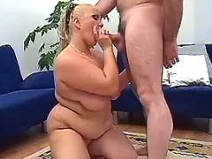 Fatty greedily sucks strong cock