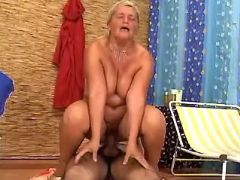 Lusty plump granny rides fresh cock