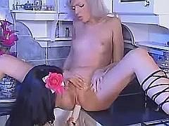 Lesbians play w sextoys in kitchen