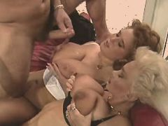 Two matures get cumshot on big tits