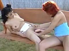 Lesbians enoy dildo on playground