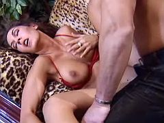 Alluring milf fucking wild on the leopard sofa