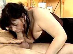 Granny greedily throats fresh cock