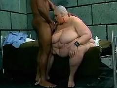 Bald big woman sucks in prison cell