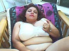 Depraved fatty dildofucks her pussy