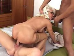 Lusty granny shared by guys in orgy