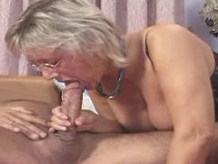 Granny throats strong cock in bed