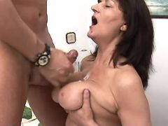Depraved mature gets cum on boobs