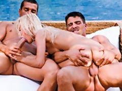 Petite blonde sweetie milks two cocks for cum