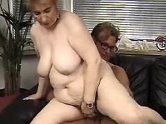 Granny jumps on hard dick in office