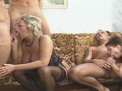 Spoiled granny sucks cocks in orgy