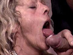 Aged mature sucks out cum in orgy