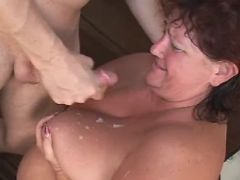 Paunchy woman gets cumload on boobs