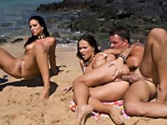 Two girls with nice tits fucking on the beach