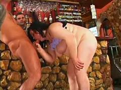 Busty fatty sucks in bar