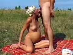 Preggy blonde sucks cock