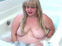Blond fatty taking bath