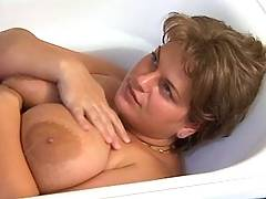 Busty fatty sucks in bath