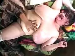 Woman oiling enormous melons