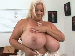 Fat mature shows big tits