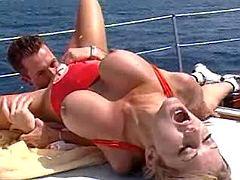 Busty babe fucks on boat