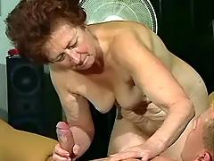 Mature gives oral massage