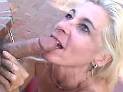Blond mom gags on a dick