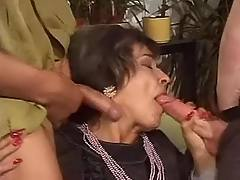 Sexy milf sucks two dicks