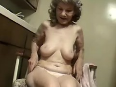 Granny dildoing herself