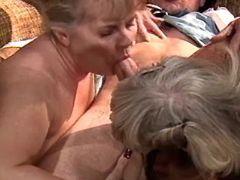 Two mature sluts in orgy