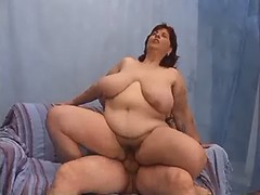 Chesty fatty jumping on cock on bed