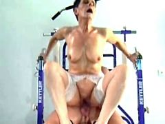 Granny rides dick in gym