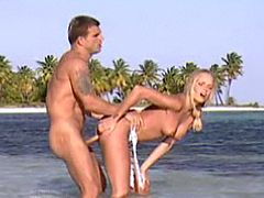Hot blonde fucks on beach