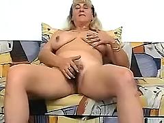Mature caresses her pussy
