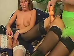 Babes dildoing on sofa